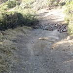 Armored crossing erosion control